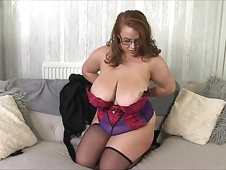 British babe Georgina Gee strips to reveal her gigantic tits and round butt then makes her nipples stiff using ice cubes